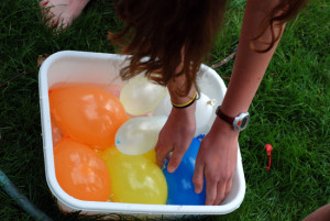 reaching for water balloons