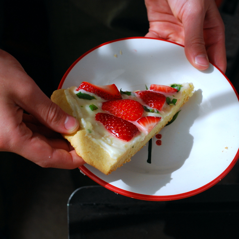 strawberry mint pizza in hands